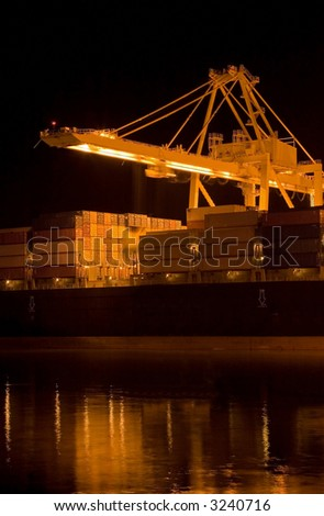 The containers and cargo of world trade move through a busy port