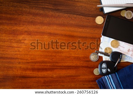 the contents of the pockets of men on a brown wooden table