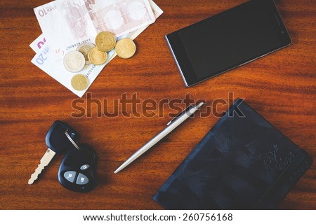 the contents of the pockets of men on a brown wooden table with instagram filter