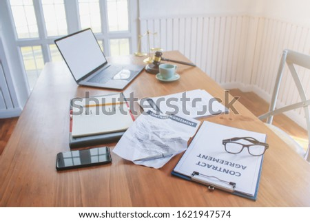 The contract that is prepared on the table in the office of the real estate manager is a contract that is given to the hire-purchase company, signing a contract to accept the installment payment.