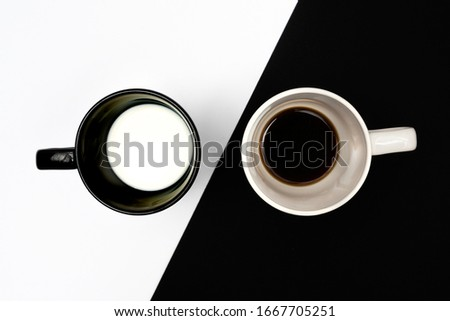 the contrast of a cup of coffee and a cup of milk Stockfoto ©