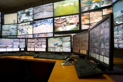 The control room of the city surveillance center. Computer monitors showing the cameras all over the city.