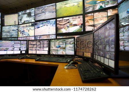 The control room of the city surveillance center. Computer monitors showing the cameras all over the city. #1174728262