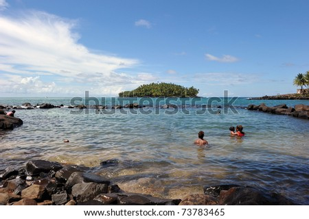 The convicts' pool of Isle Royale, French Guiana. In the background, Devil's island. Long ago a French prison, now those islands are a tourist attraction and station for the Guiana Space centre.