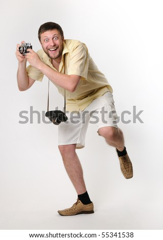 The cool man in shorts the photographer