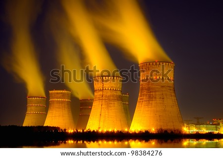 The cooling towers at night of the nuclear power generation plant
