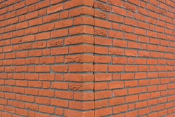 The corner of an orange brick wall texture