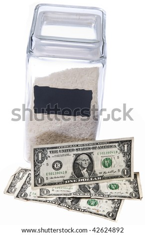 The cost of rice is rising. A canister of rice with american dollar bill currency. Price of food staples theme.