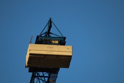 the counterweight of the crane on blue sky background
