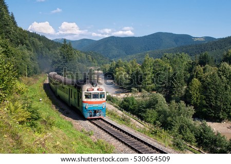 The countryside and the railroad in the Ukrainian Carpathians. Diesel passenger train arrives at the station Tatariv (Tatarov), Ivano-Frankivsk region, Yaremche district, Ukraine. D1 diesel train.