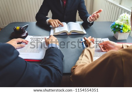 The couple consulting a lawyer about agreement on the divorce. #1154554351