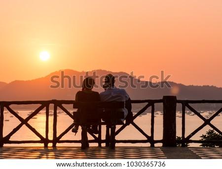 the couple enjoying beatiful sunset,Romantic time of sunset