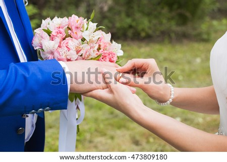 The couple exchange wedding rings #473809180