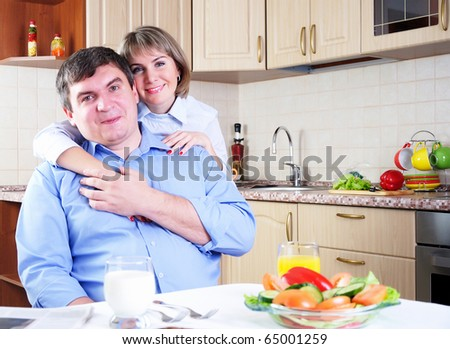 The couple has breakfast together in the kitchen