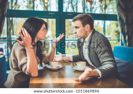 The couple quarreling in the restaurant