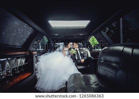 The couple sitting in the limo. Portrait of a beautiful young couple who rides around the city.