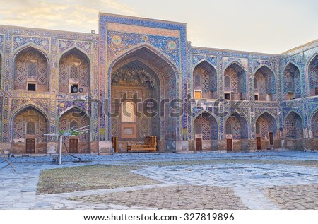 The courtyard of Sher-Dor Madrasah with the colorful patterns on the bright blue walls, Samarkand, Uzbekistan.