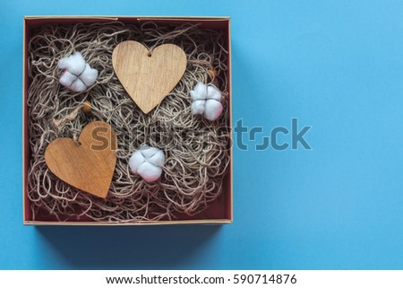 The craft gift box with the heart card and cotton flowers on the blue background #590714876