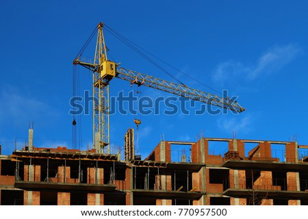 The crane on the construction of an apartment building #770957500