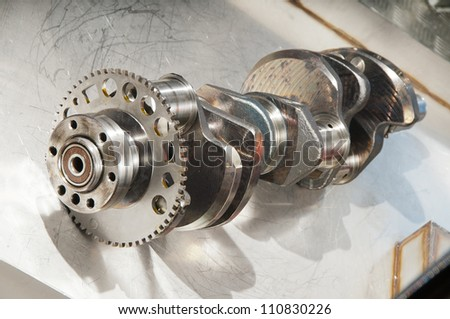 The crankshaft from a sports car engine