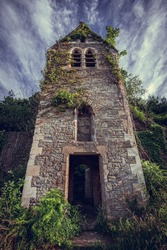 The creepy derelict shell of St. Mary's Church in Tintern, Wales