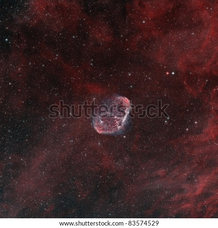 """The Crescent Nebula in Hydrogen Alpha and Oxygen. The """"Soap Bubble"""" nebula is also visible on the top left. - stock photo"""