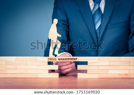 The crisis manager helps company overcome crisis after covid-19 to start new phase of business. Crisis is an opportunity concept. Post covid-19 era management helping hand concept. Stock photo ©