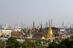 The crisis of Pm2.5 in Bangkok Thailand. the bird eye view of the grand palace (Wat Phra Keaw) with many modern skyscrapers and grey color sky at the background