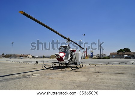 The crop duster is replaced with this small helicopter outfitted with liquid hoppers and spray nozzles