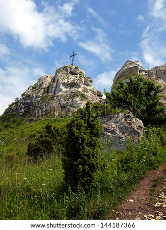 The cross on the background of clear sky at the top Biaklo (or Maly Giewont) near Olsztyn near Czestochowa in Poland