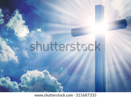 The Cross with bright sun and clouds in the background