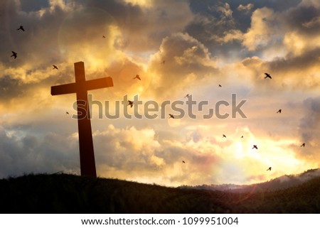 The cross with sunset in the sky background. make a mental image ..PS.. #1099951004