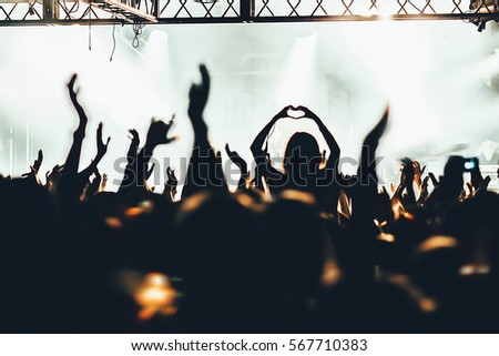 The crowd of fans at concerts. Hands fans.\ \ Russia, St. Petersburg