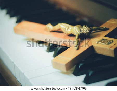 the crucifix of jesus on piano...