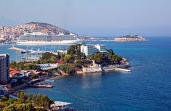 The cruise ship is located on Kusadasi Island in the port of Kusadasi, Turkey