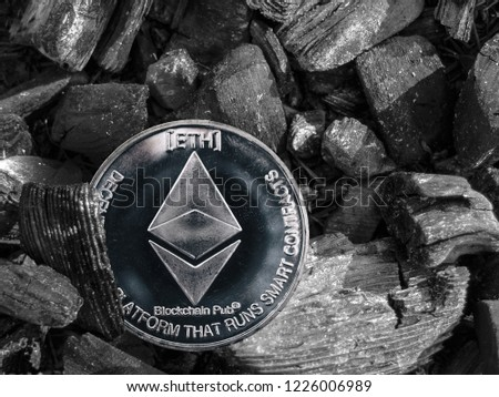 The cryptocurrency Ethereum coin lies on coal. Mining and Energy for mining.