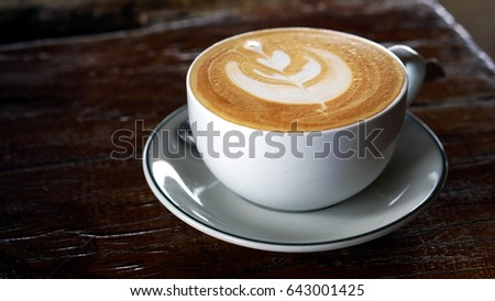 The cup of latte or cappuccino coffee with milk.