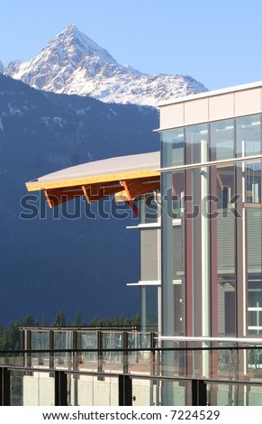 The curving roofline and glass architecture of a university in Squamish, BC, Canada.