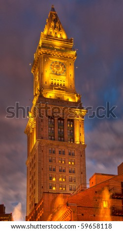The Customs House glows with golden light with a blue and pink sky