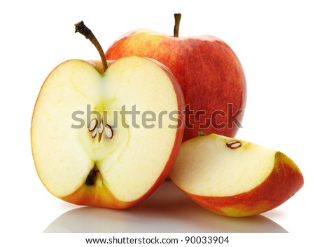 The cut and whole apple. A detailed photo of fruit on a white background