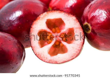 The cut cranberry. Small depth of sharpness. Focus on the cut berry