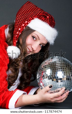 The cute girl with Christmas cap and mirror ball