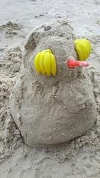 The cute penguin sand doll
