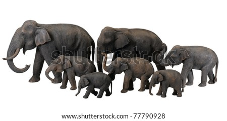 The cute wooden elephants and their calf