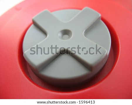 the d-pad of a red video game controller