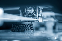 The 3D printing machine operation. The 3D rapid prototype processing concept.