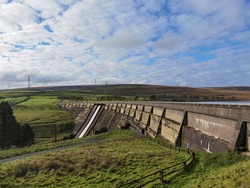 The dam of Baitings Reservoir on a bright autumn day, Calderdale, West Yorkshire, UK