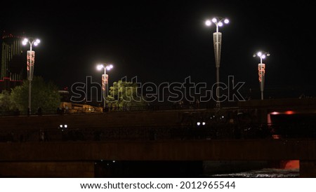 The dam of the Ekaterinburg city with lanterns and the Iset River, Russia. Stock footage. A bridge above the rive at night on black sky background. Photo stock ©