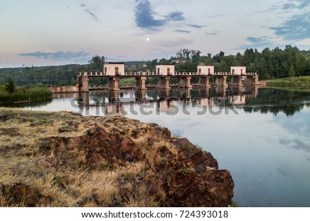 the dam on the river in the evening, the river Iset Kamensk-Ural'skiy #724393018