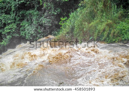 The dangerous flash flood of the water fall in the rainy season in Thailand.
